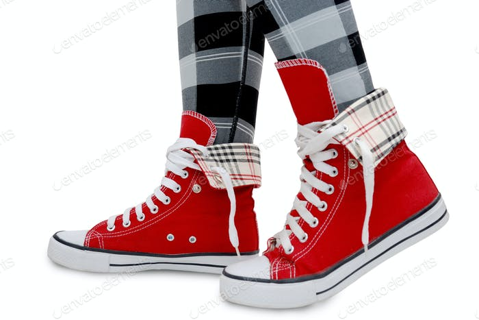 Red sneakers, checkered leggings.