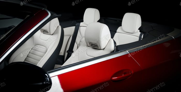 Red cabriolet car, seats in modern luxury car