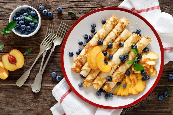 Sweet crepes filled with fresh blueberry and peach