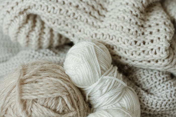 Cozy composition with knitted yarn in pastel colors.