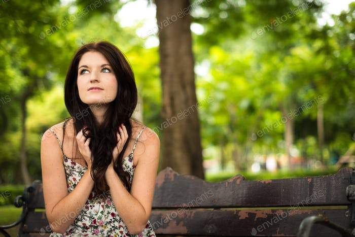 Portrait of young beautiful woman at the park outdoors