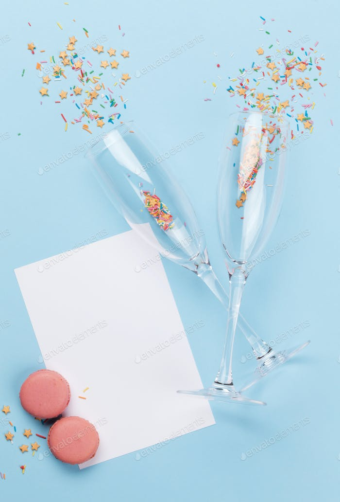 Champagne glasses and colorful sweets holiday