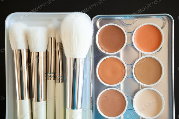 Make up and cosmetics products on black background