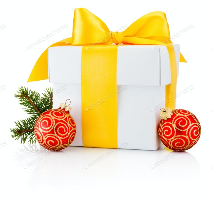 White gift box tied yellow ribbon and two Christmas bauble Isola