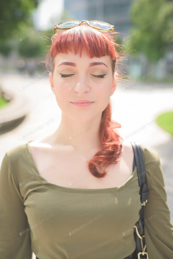 young handsome redhead woman with eyes closed