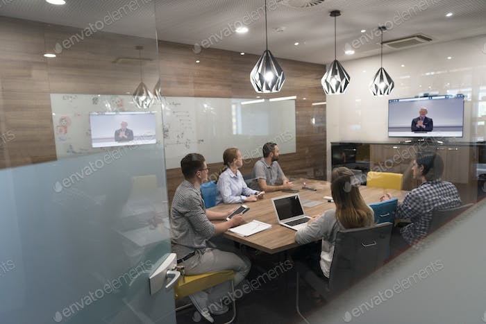 start up business people group attending videoconference call