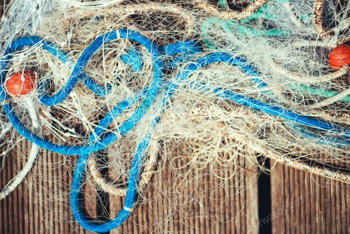Pile of commercial fishing net with cords and floats