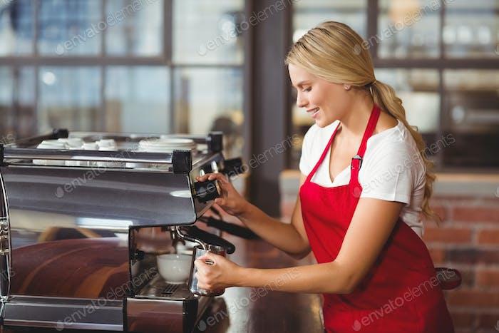 A pretty barista preparing coffee at the coffee shop