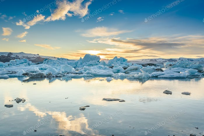 Scenic view of icebergs in Jokulsarlon glacier lagoon, Iceland, at sunset