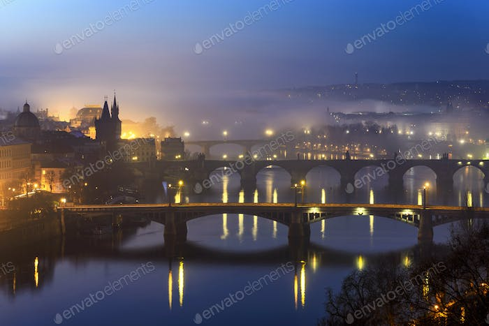 Charles bridge during foggy morning at Prague