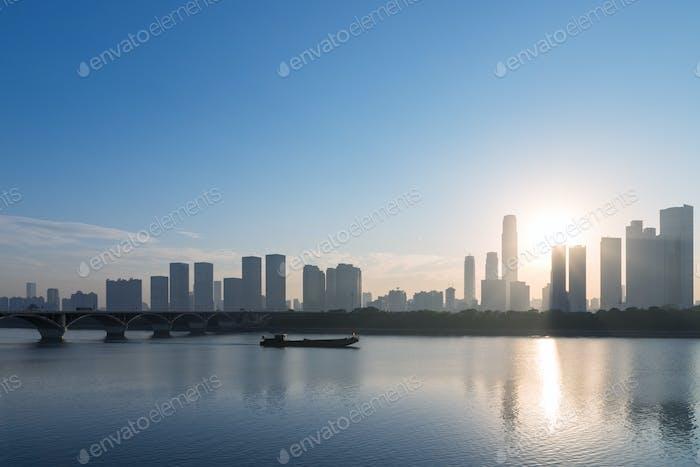 changsha skyline in morning, modern building silhouette on xiangjiang riverside