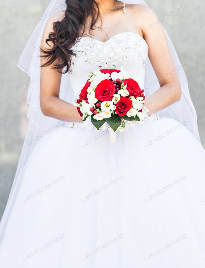Wedding flowers ,Woman holding colorful bouquet with her hands on wedding day