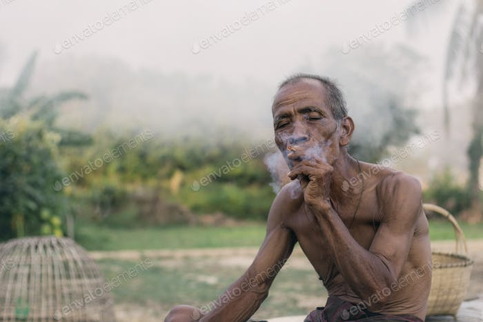 Asian men smoking cigarettes