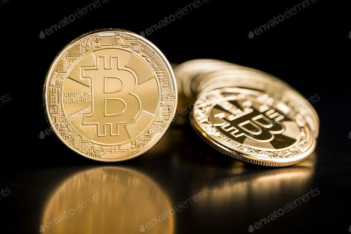 Thumbnail for Golden bitcoins. Coin of cryptocurrency.