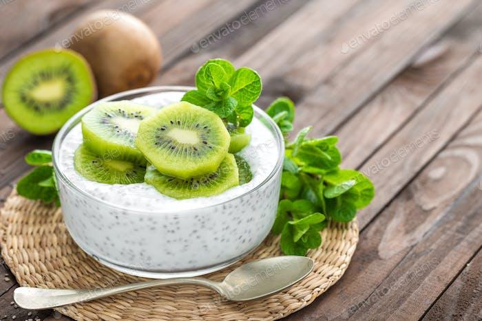 Fresh kiwi yogurt with fruits and chia seeds, healthy breakfast