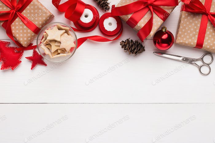 Packing Christmas presents concept, top view with copy space