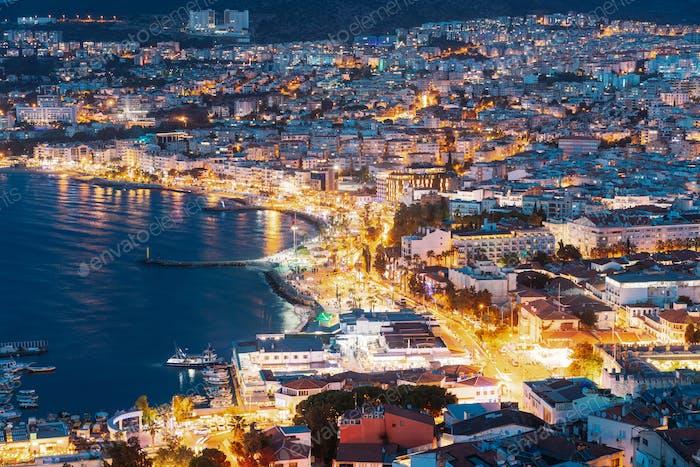Kusadasi, Aydin Province, Turkey. Waterfront And Kusadasi Cityscape In Summer Evening. Night Scenic