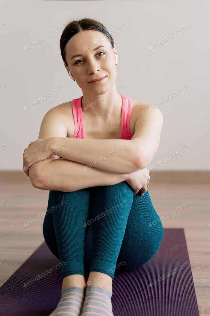 Portrait caucasian woman practicing yoga at home