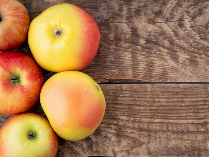 set of apples on wooden rustic table antique.