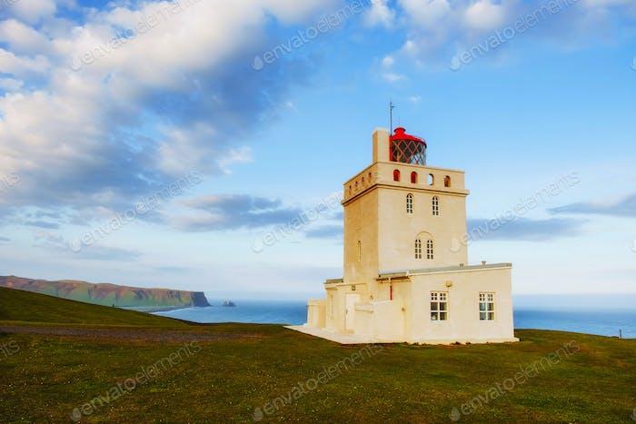 Beautiful white lighthouse at Cape Dyrholaey, South Iceland