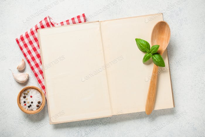Cooking concept with cookbook on kitchen table