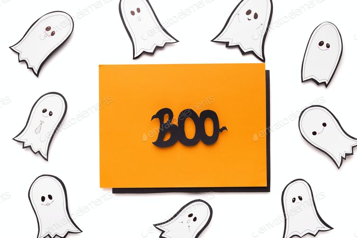 Happy halloween greeting card with flying ghosts