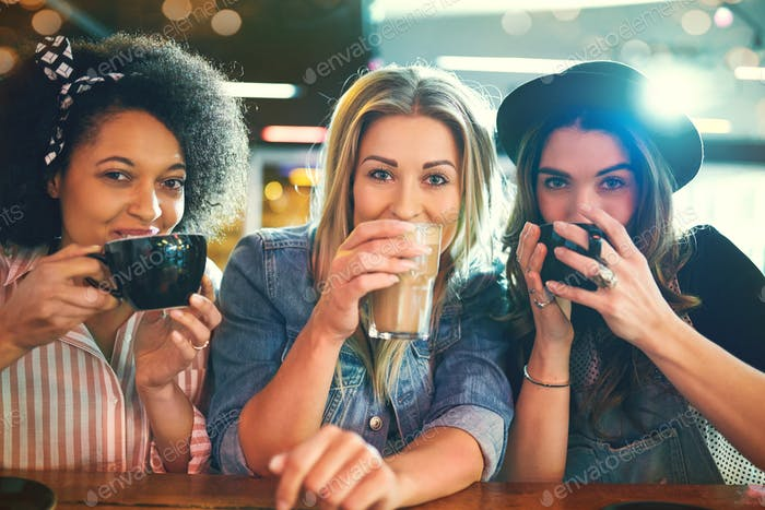 Young women sipping coffee