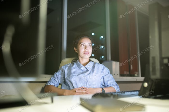 Latin-American Woman Working at Night