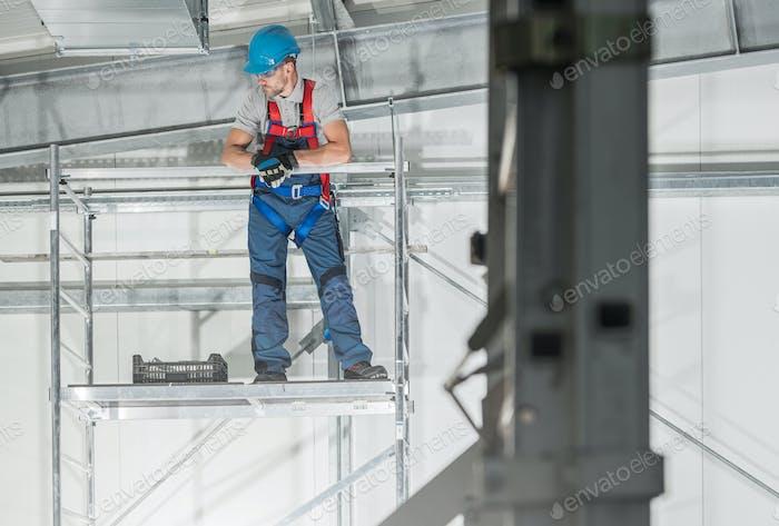 Professional HVAC Technician Worker on Scaffolding