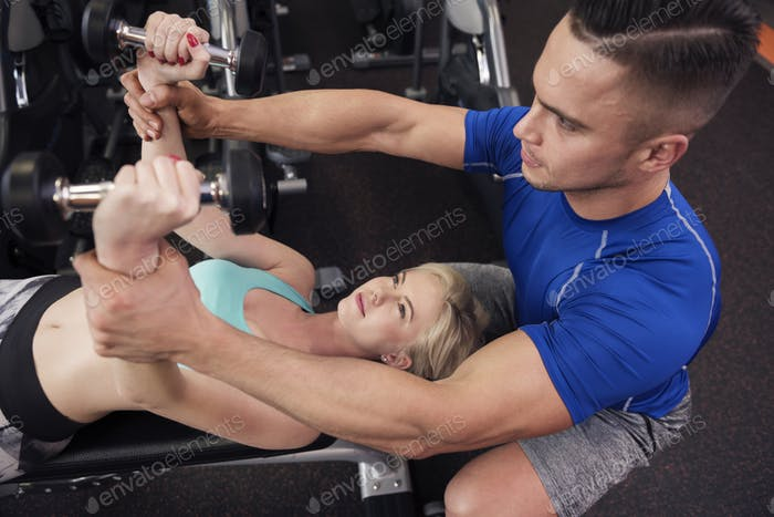Woman exercising on weight bench