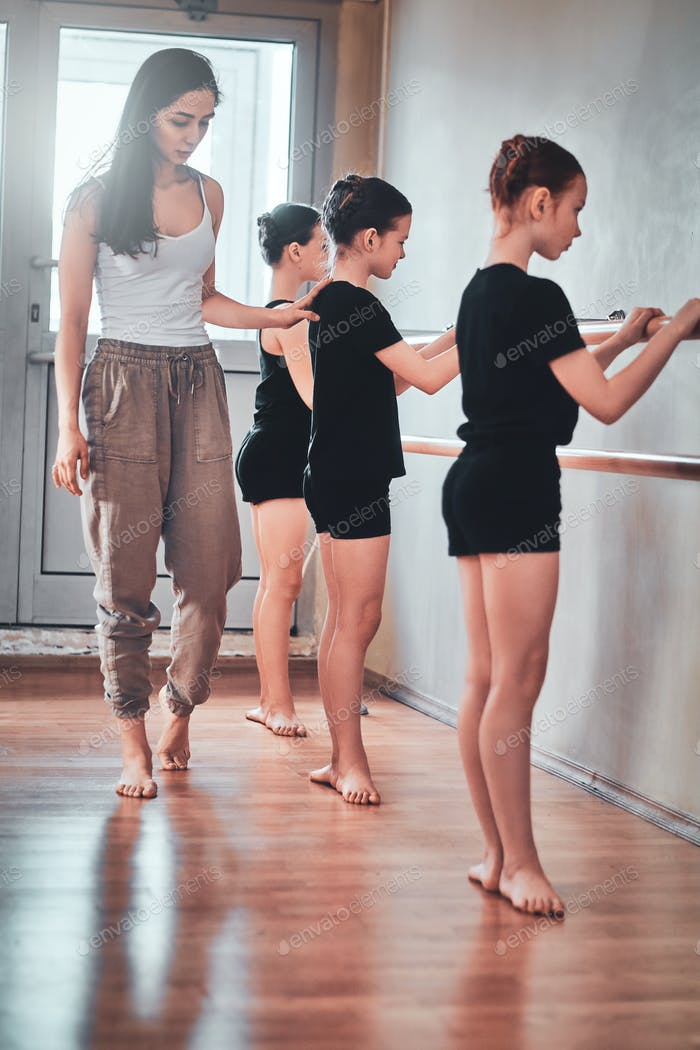 Daily rehearsal of young ballerinas with teacher