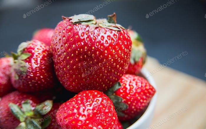 strawberries in white dish