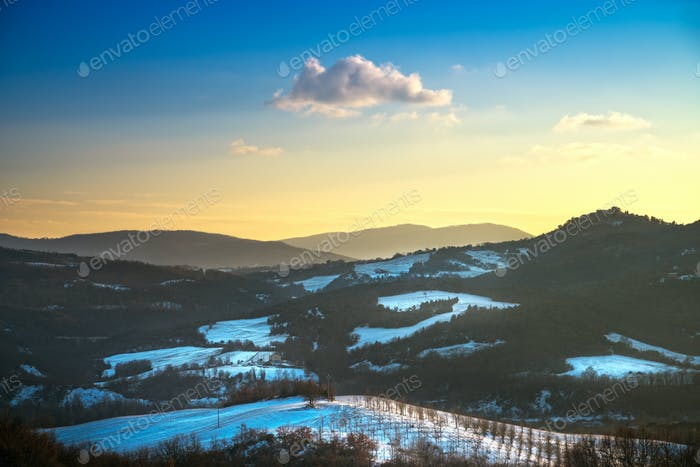Snow in Tuscany. Winter panorama view at sunset. Siena, Italy