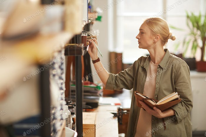 Woman Checking Availability Of Materials