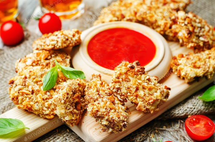almond crusted chicken tenders with ketchup