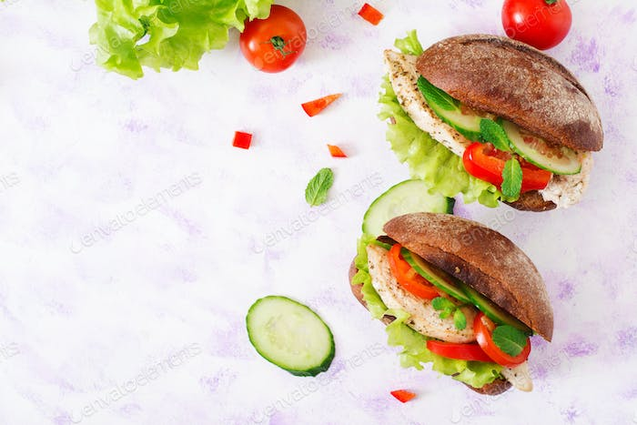 Two delicious and healthy sandwich hot dog with chicken and vegetables. Top view