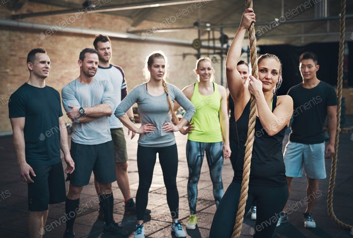 Woman holding climbing rope in cross-fit exercises