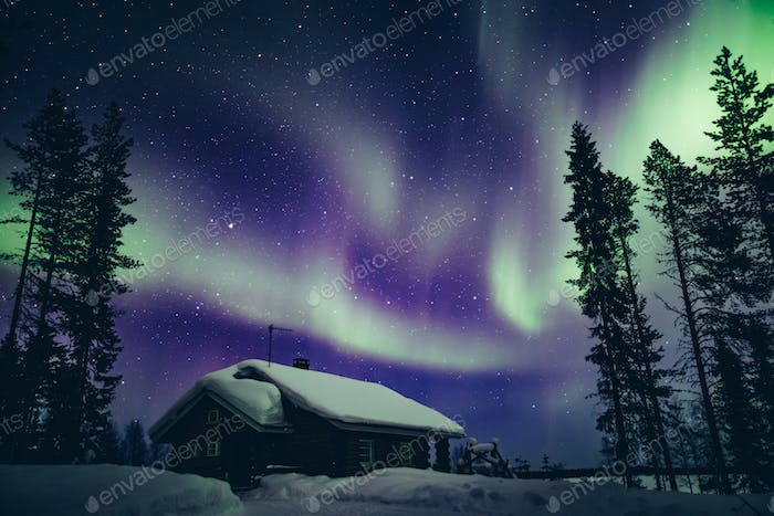 Colorful polar arctic Northern lights Aurora Borealis activity in winter Finland