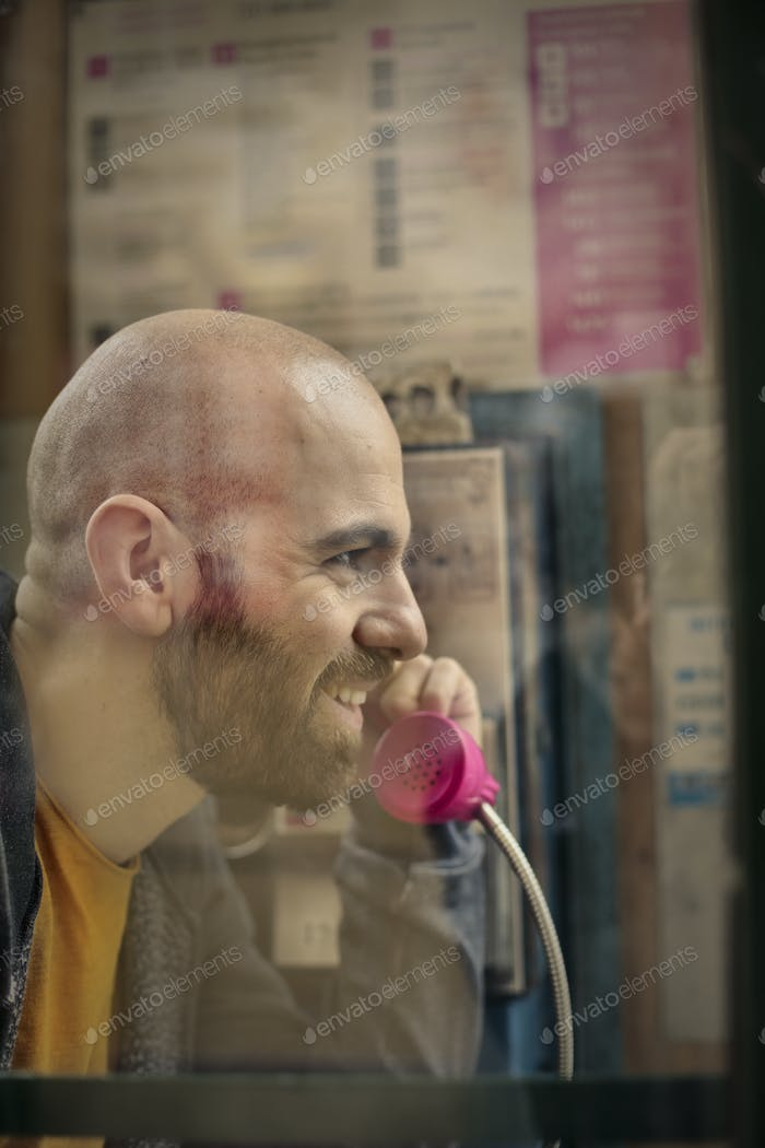 Man on a phone booth
