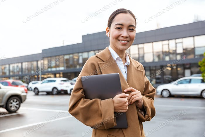 Smiling young asian businessowoman