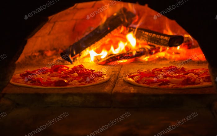 Italian pizza is cooked in wood-fired oven
