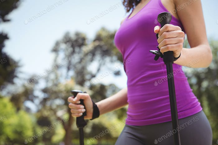 Fit woman hiking in the park on a sunny day