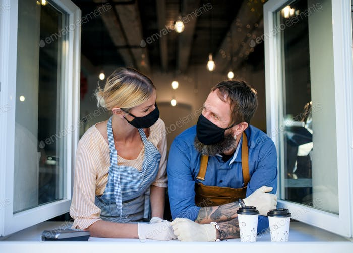 Coffee shop owners with face masks, lockdown, quarantine, coronavirus, back to normal concept