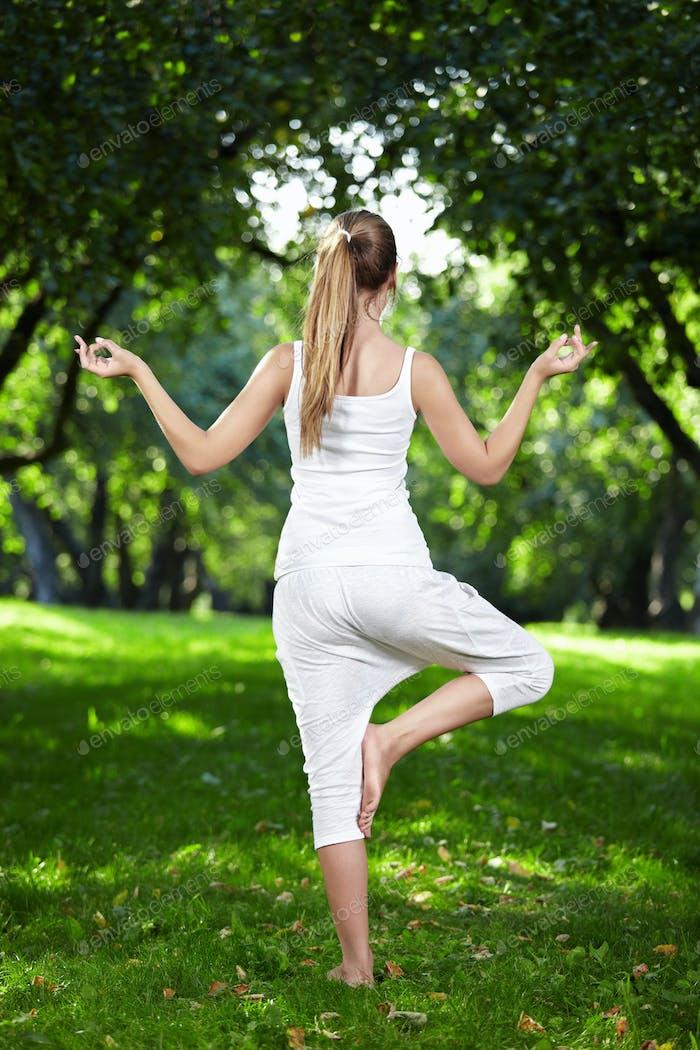 Girl do yoga back