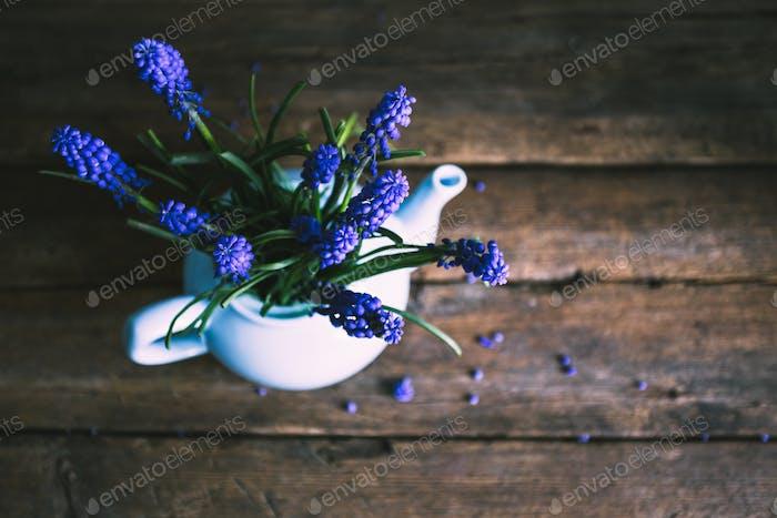 Blue flowers in a vase. Vintage