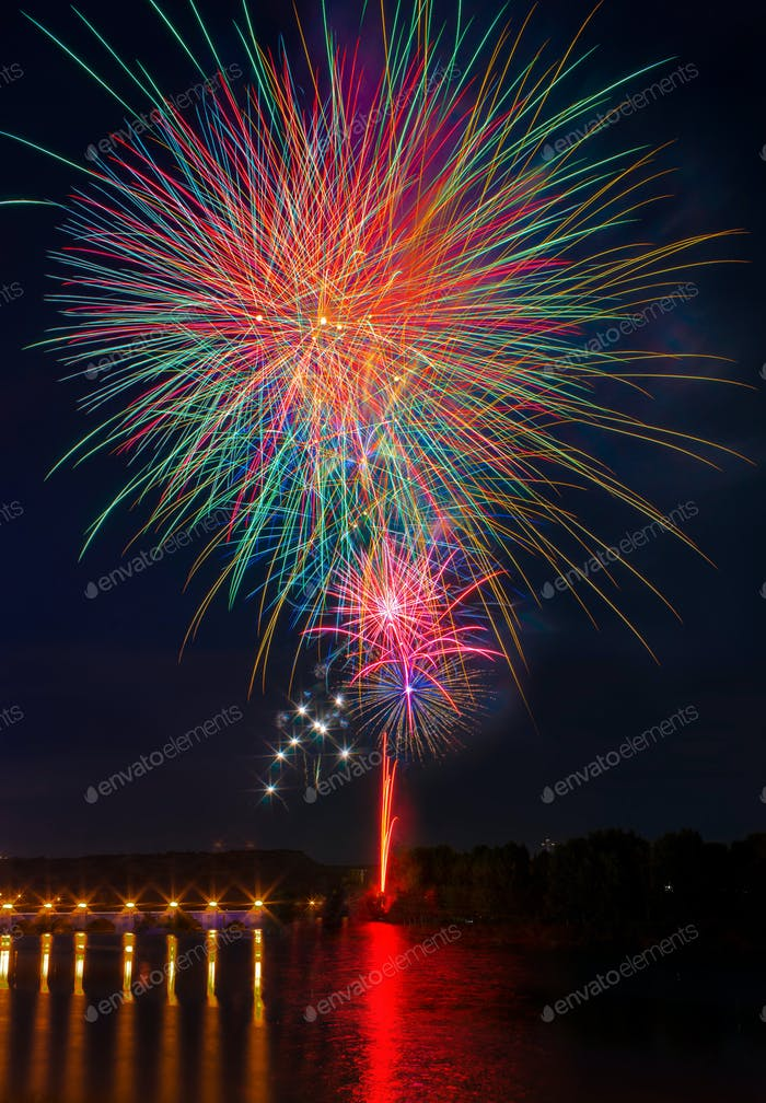 fireworks reflected in the river water