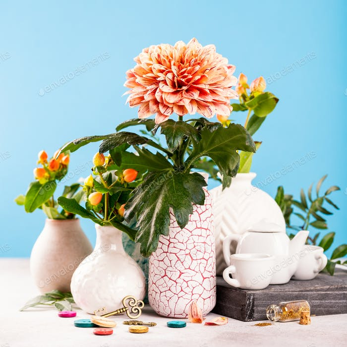 Vase with beautiful chrysanthemum flowers on light table