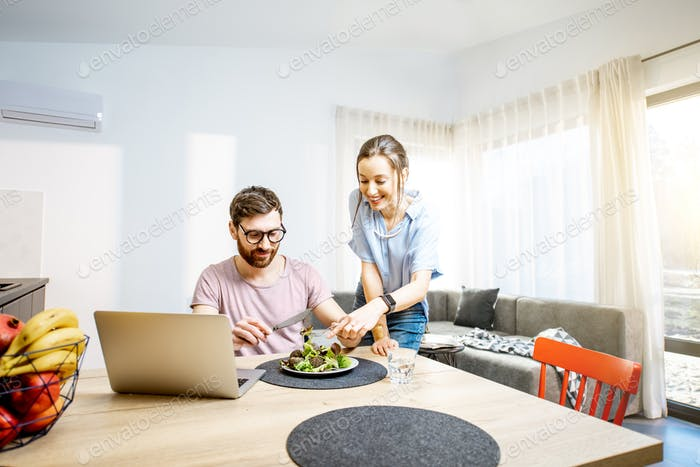 Young couple dinning in the living room