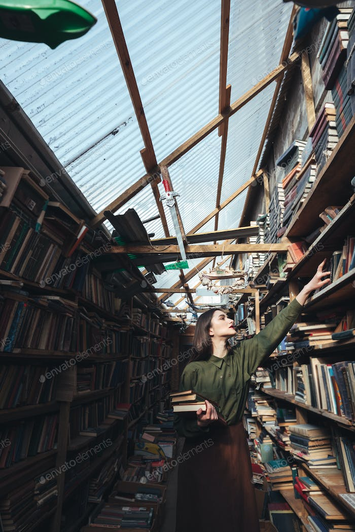 Vertical image of girl in library
