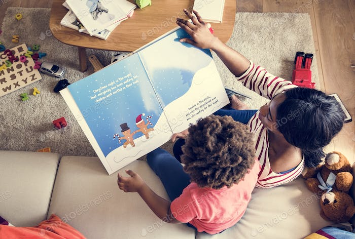 Mom reading picture book with her son